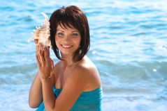 Young woman with seashell Stock Photos