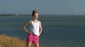 Young woman doing sports outdoors, yoga stock footage