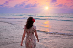 Young woman on seashore at sunset Royalty Free Stock Photos