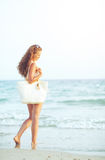 Young woman at seaside in the evening Royalty Free Stock Photo