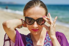 Young woman at a seaside resort .Walks in the fresh air royalty free stock image