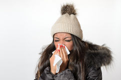 Young woman with a seasonal winter cold Stock Images