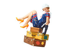 Young woman seat on vintage suitcases Royalty Free Stock Images