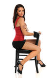 Young Woman Seated on Black Chair Stock Photography