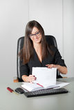 Young woman secretary sort by size letters Royalty Free Stock Image