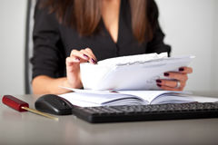 Young woman secretary sort by size letters Stock Images