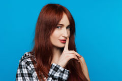 Young woman secrets. Gesture silent stock photography
