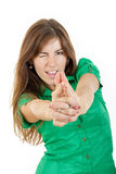 Young woman with seductive look making with hands fingers sign l Stock Images