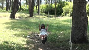 Young woman on seesaw stock video