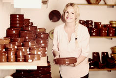 Young woman selecting ceramic dish ware in atelier Stock Photography