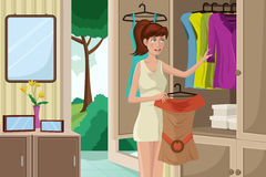 Young woman selecting an outfit. A vector illustration of  young woman selecting an outfit from her wardrobe Stock Photography