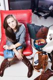 Young woman selecting shoes. Young woman selecting right pair of shoes Stock Image