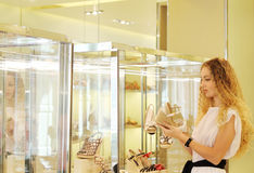 Young woman selecting shoes at a store Stock Photos