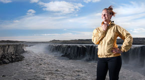 Young woman with Selfoss waterfall in background Royalty Free Stock Images
