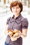 Young woman selling baguettes Stock Photography