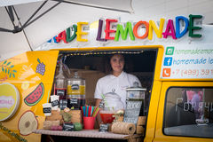 Young woman sells fresh homemade lemonade from food track Stock Photo