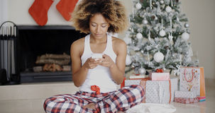 Young woman sending a Christmas message Royalty Free Stock Photo