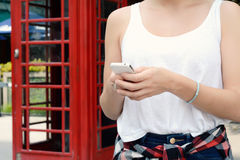 Young woman sending messages with her smartphone. Portrait of a young beautiful woman sending messages with her smartphone. Outdoors Royalty Free Stock Images
