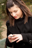 Young woman is sending a sms Stock Images