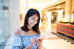 Young Woman sending sms on mobile phone Stock Images