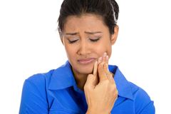 Young woman with sensitive tooth ache crown problem. Closeup portrait of young woman with sensitive tooth ache crown problem about to cry from pain touching stock photos