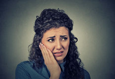 Young woman with sensitive toothache crown problem about to cry from pain. Closeup portrait young woman with sensitive toothache crown problem about to cry from stock photos