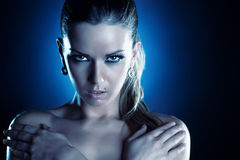 Young woman serious portrait. Cold blue tint Royalty Free Stock Photography