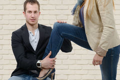 Young woman sets foot on her lover Royalty Free Stock Images