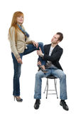 Young woman sets foot on her lover Royalty Free Stock Photos