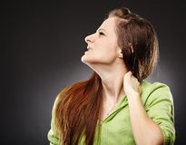Young woman with a severe pain in the neck Royalty Free Stock Images