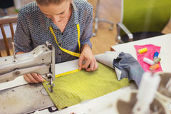 Young woman with sewing machine Royalty Free Stock Photo