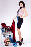 Young woman with a sewing machine dressed in black skirt Royalty Free Stock Photography