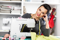 Young woman at a sewing machine Stock Image