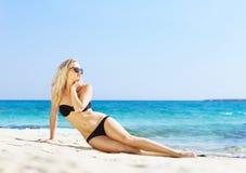 Young woman in a sexy bikini posing on the beach Royalty Free Stock Photos