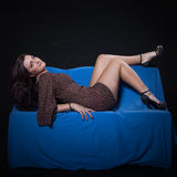 Young woman in sexy dotted mini dress Royalty Free Stock Image