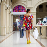 Young woman in sexy dress walking in the shop Royalty Free Stock Photos