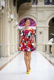 Young woman in sexy dress walking in the shop Royalty Free Stock Image