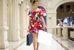 Young woman in sexy dress walking in the shop Stock Photos