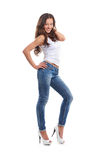 A young woman in sexy jeans and a white shirt Stock Photos