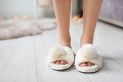 Young woman with legs in fluffy slipper. S indoors stock photos