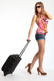 Young woman with sexy long legs going on holiday Stock Photography