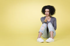 Young woman with sexy look pointing at you on yellow background. Royalty Free Stock Images