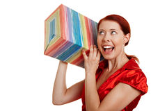 Young woman shaking gift Royalty Free Stock Images