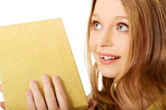 Young woman shaking the gift box Stock Images