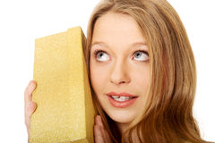 Young woman shaking the gift box Stock Photos