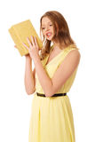 Young woman shaking the gift box Stock Photography