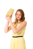 Young woman shaking the gift box Royalty Free Stock Image
