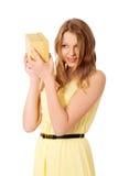 Young woman shaking the gift box. Teenage woman shaking the gift box Royalty Free Stock Images