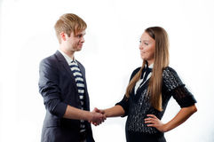Young woman shaking hand to a young man Royalty Free Stock Photos