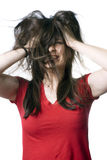 Young woman shaking her hair Stock Photo